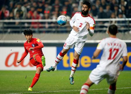 Football Soccer - South Korea v Syria - World Cup 2018 Qualifiers - Seoul World Cup Stadium, Seoul, South Korea - 28/3/17 - South Korea's Kim Jin-su shoots the ball.  REUTERS/Kim Hong-Ji