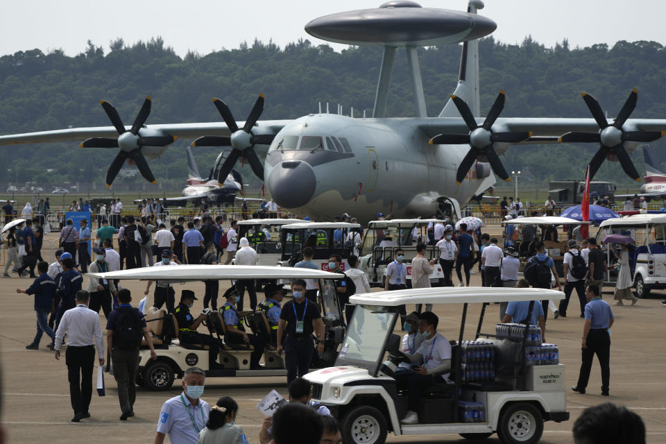 Visitors look at the Chinese military's KJ-500 airborne early warning and control aircraft during 13th China International Aviation and Aerospace Exhibition, also known as Airshow China 2021, on Wednesday, Sept. 29, 2021, in Zhuhai in southern China's Guangdong province. With record numbers of military flights near Taiwan over the last week, China has been stepping up its harassment of the island it claims as its own, showing an new intensity and sophistication as it asserts its territorial claims in the region. (AP Photo/Ng Han Guan)