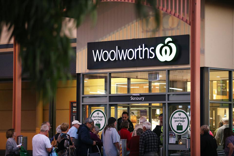 Customers wait outside a Woolworths in Sunbury. Source: Getty