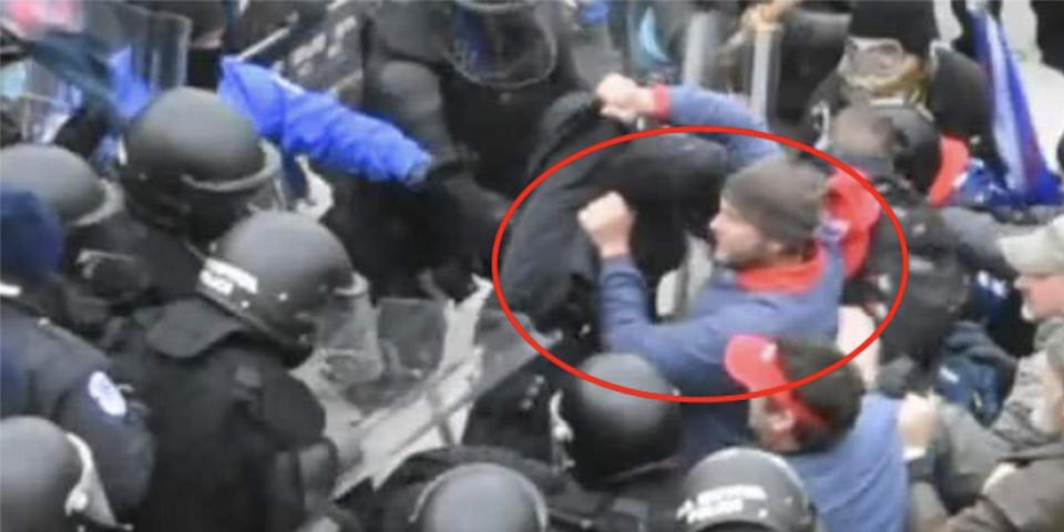 A screenshot from footage, shot from above, of police attempting to halt rioters outside the Capitol. The man who FBI believes is Landon Copeland is circled.
