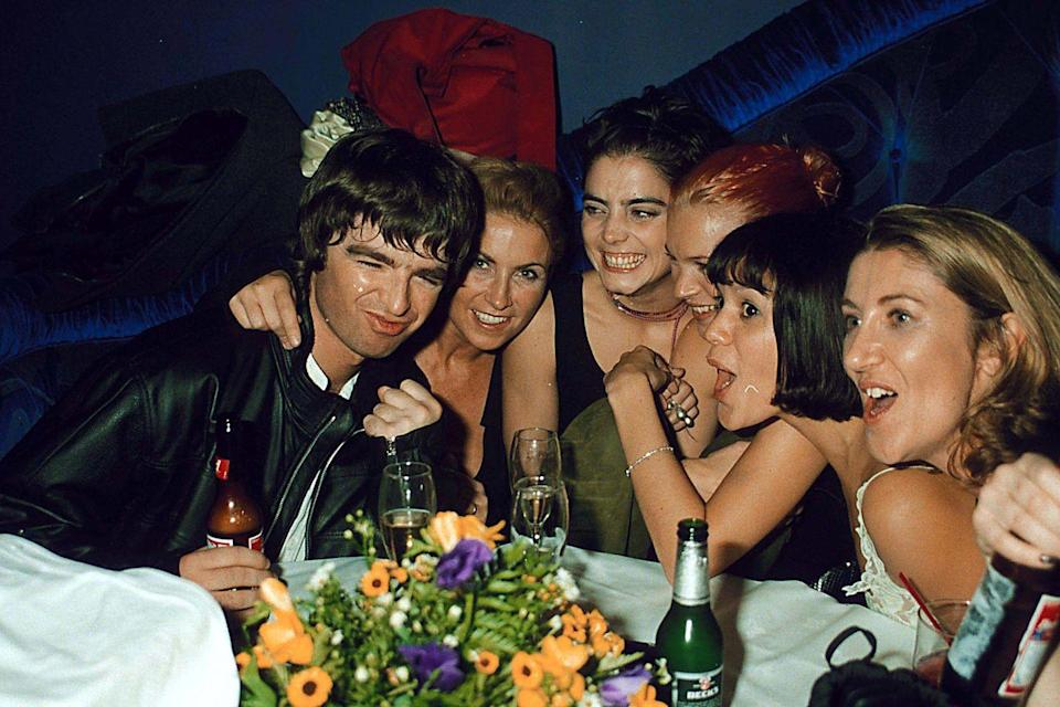 <p>Noel Gallagher at a party in London in October 1998. (Kate Moss is third from the right.) </p>