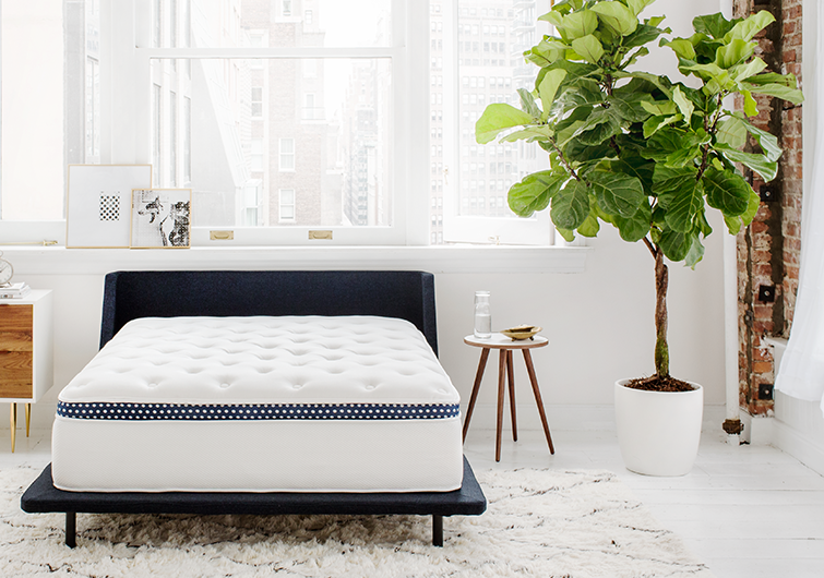 """<h3><a href=""""https://www.winkbeds.com/pages/shop-winkbed"""" rel=""""nofollow noopener"""" target=""""_blank"""" data-ylk=""""slk:Wink Beds The WinkBed Mattress"""" class=""""link rapid-noclick-resp"""">Wink Beds The WinkBed Mattress</a></h3><br><strong>Mattress Type: </strong>Hybrid (Foam & Spring)<br><strong>Sleeper Style: </strong>Restless<br><strong>Pros: </strong>Sink-Into-Bed Support<br><strong>Cons: </strong>Aesthetic Durability<br><br>""""This was a serious best mattress winner for me. It's handmade in Wisconsin when ordered, so it takes a couple of weeks to arrive, but other than the wait I had no real complaints. Right out of the literal box, it was fluffy, supportive, and odor-free. The blue-and-white trim around the top looks pretty regal, and this bed softened up to my liking within a week or two.""""<br><br>""""Wink's main and original mattress is a hybrid (coils and foam) and comes in four variations: softer, luxury firm, firm, and plus. They also make a memory foam bed and an eco-friendly mattress featuring 100% natural materials. I chose the luxury firm, their most popular style, and as someone who likes to sink into their bed, I wasn't disappointed. But it's nice that they have so many options. Their Plus model is also one of the best mattress options because it's one of the only bed-in-a-box, luxury beds to accommodate heavier weights.""""<br><br>""""The mattress itself has a Tencel cover, which sleeps cooler than linen, wicks away heat, and is softer than silk, according to the site. Then there's a gel-infused memory foam layer, which is what provides a lot of the immediate comfort you feel when you lie down, individually wrapped coils, and great edge support (something you'll really come to appreciate when you share your bed with little kids).""""<br><br>""""My only gripe: when I change the sheets, the top of the mattress already looks very used even though it's only a couple of months old, so that's definitely a little disappointing. Otherwise, when I go to sleep, I stay asleep. No tossing a"""