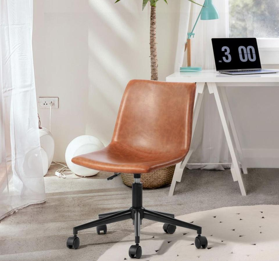 """Make your meetings run smoothly with thisleather office chair that features a padded backrest and seat so you're comfortable. It has five legs for when you feel like moving around throughout the day and a lever to adjust the height as well.<a href=""""https://fave.co/2J3AKcB"""" target=""""_blank"""" rel=""""noopener noreferrer"""">Originally $122, get it now for $90 at The Home Depot</a>."""
