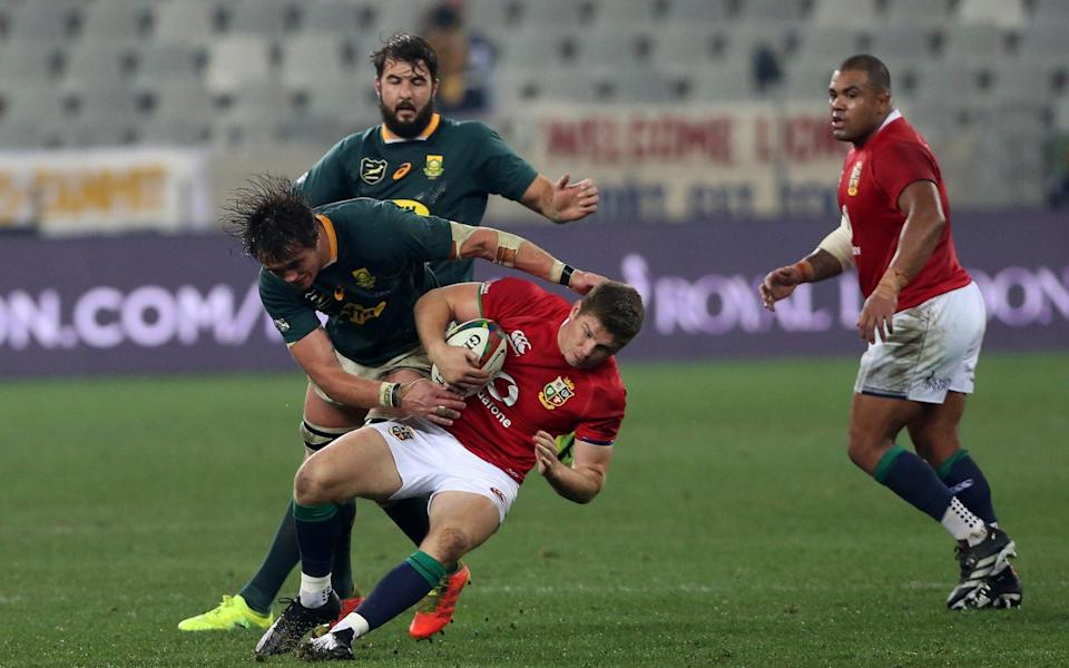 Owen Farrell of the British & Irish Lions is tackled by Franco Mostert of South Africa during the 2nd Test between South Africa - Getty Images