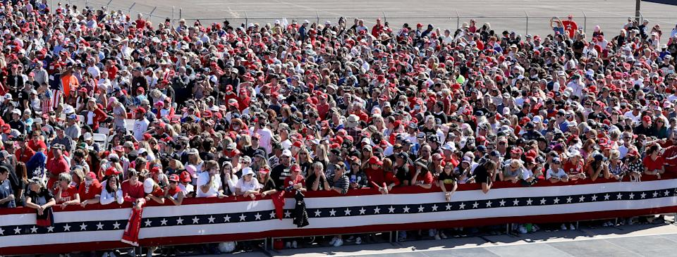 GOODYEAR, ARIZONA - OCTOBER 28: With few face masks and no social distancing to reduce the risk posed by the coronavirus, supporters wait for the arrival of U.S. President Donald Trump during a campaign rally at Phoenix Goodyear Airport October 28, 2020 in Goodyear, Arizona. With less than a week until Election Day, Trump and his opponent, Democratic presidential nominee Joe Biden, are campaigning across the country. (Photo by Chip Somodevilla/Getty Images)