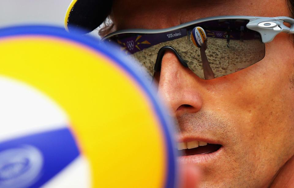 Emanuel Rego of Brazil prepares to serve during the Men's Beach Volleyball Round of 16 match between Brazil and Germany. (Getty Images)