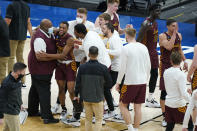 Loyola of Chicago players celebrate after a college basketball game against Illinois in the second round of the NCAA tournament at Bankers Life Fieldhouse in Indianapolis Sunday, March 21, 2021. Loyola upset Illinois 71-58. (AP Photo/Mark Humphrey)