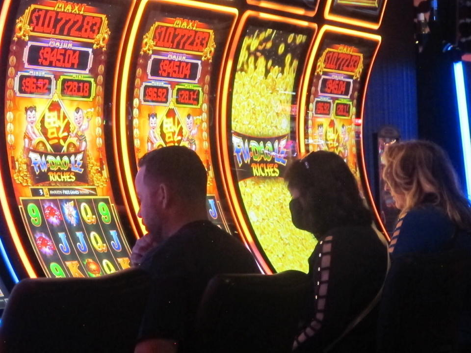 This June 4, 2021 photo shows gamblers playing slot machines at the Ocean Casino Resort in Atlantic City, N.J. Last year Ocean, the former Revel casino, rose to third place out of nine casinos in terms of the amount of money won from in-person gamblers in Atlantic City. (AP Photo/Wayne Parry)