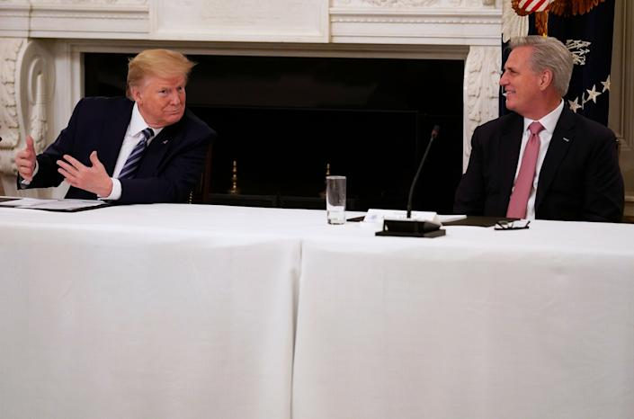 President Donald Trump speaks with House Minority Leader Kevin McCarthy (R-Calif.) during a meeting with Republican lawmakers Friday at the White House. (Photo: Evan Vucci/ASSOCIATED PRESS)