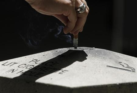 A woman disposes a cigarette in Los Angeles, California