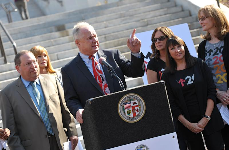 "Los Angeles Councilmember Tom LaBonge, center, appears at the Stand Up To Cancer Day announcement at Los Angeles City Hall on Tuesday, Sept. 4, 2012. Councilmember Paul Koretz, left, and the City of Los Angeles held the news conference to declare Sept. 7 as the official ""Stand Up To Cancer Day"" in Los Angeles. (Photo by John Shearer/Invision/AP)"