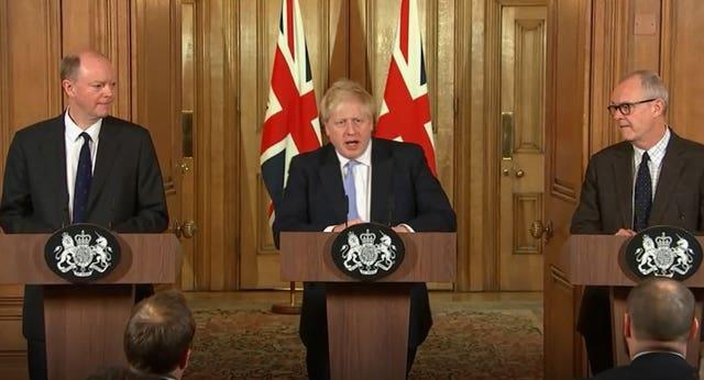 Prime Minister Boris Johnson (centre) with chief medical officer for England Chris Whitty (left) and chief scientific adviser Sir Patrick Vallance (right), speaking during a press conference, at 10 Downing Street, in London (TV Pool/PA)