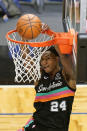 San Antonio Spurs guard Devin Vassell (24) dunks the ball against the Orlando Magic during the second half of an NBA basketball game, Monday, April 12, 2021, in Orlando, Fla. (AP Photo/John Raoux)
