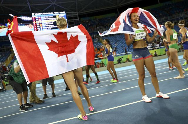 2016 Rio Olympics - Athletics - Final - Women's Heptathlon 800m - Olympic Stadium - Rio de Janeiro, Brazil - 13/08/2016. Silver medal winner Jessica Ennis-Hill (GBR) of Britain (R) and bronze medal winner Brianne Theisen-Eaton (CAN) of Canada celebrate after the event. REUTERS/Kai Pfaffenbach FOR EDITORIAL USE ONLY. NOT FOR SALE FOR MARKETING OR ADVERTISING CAMPAIGNS.