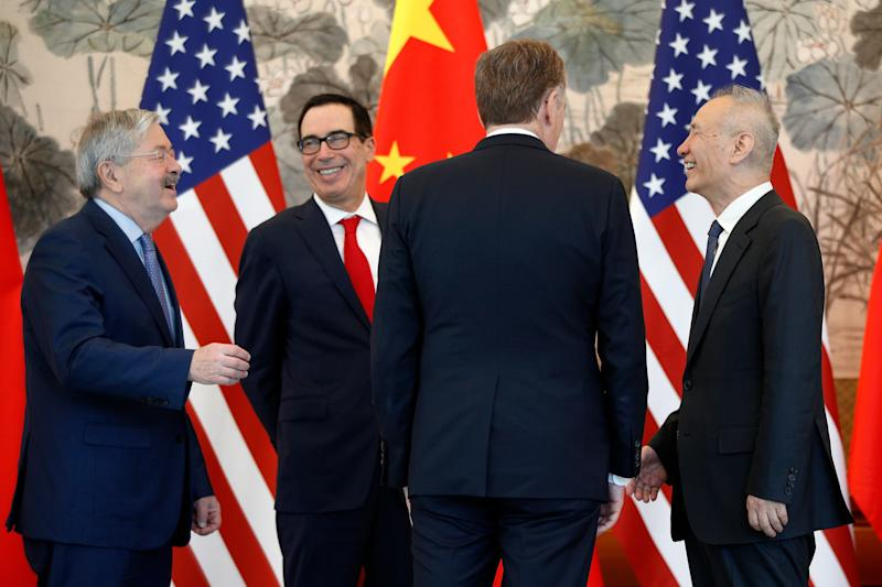 Chinese Vice Premier Liu He, right, talks with U.S. Treasury Secretary Steven Mnuchin, second from left, U.S. Trade Representative Robert Lighthizer, second from right, and U.S. Ambassador to China Terry Branstad, left, after concluding their meeting at the Diaoyutai State Guesthouse in Beijing, Wednesday, May 1, 2019. (AP Photo/Andy Wong, Pool)