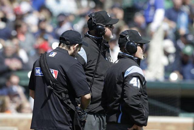 In the future, umpires may have to explain replay rulings to the crowd. (AP Photo)