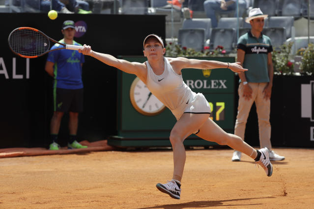 Romania's Simona Halep returns the ball to Ukraine's Elina Svitolina during the final match at the Italian Open tennis tournament, in Rome, Sunday, May 20, 2018. Svitolina won 6-0, 6-4. (AP Photo/Gregorio Borgia)