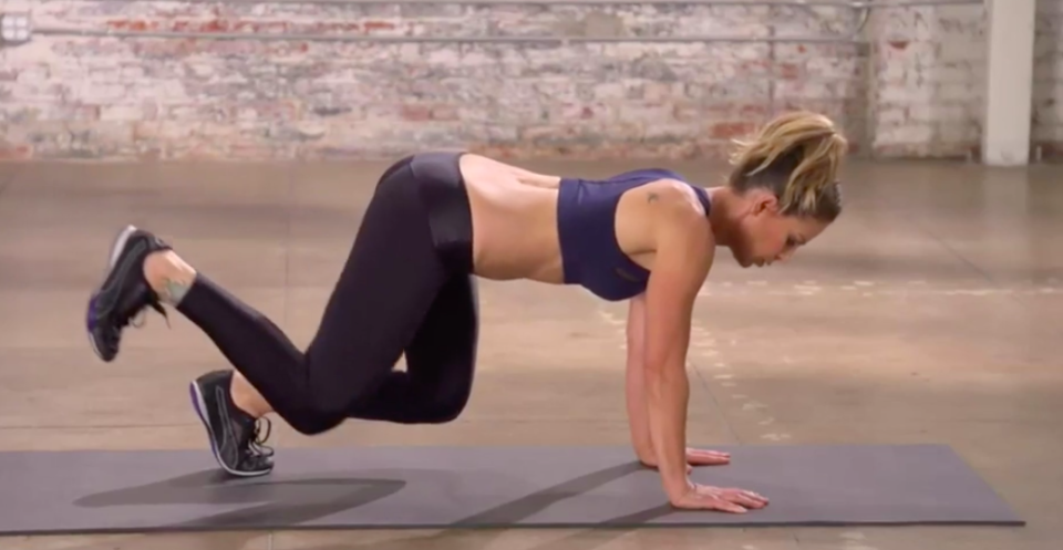 The most challenging part of this move is keeping your knees off the ground. (Photo: Courtesy of Jillian Michaels)