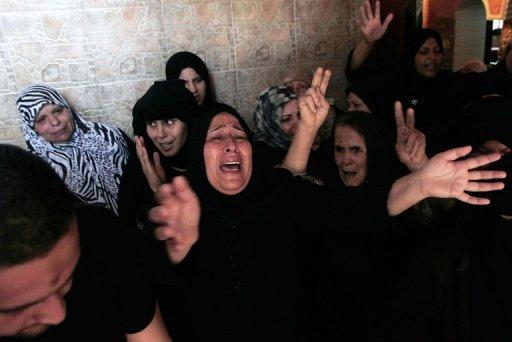 Relatives of Palestinian militant Yasser al-Atal mourn during his funeral in Khan Yunis in the southern Gaza Strip