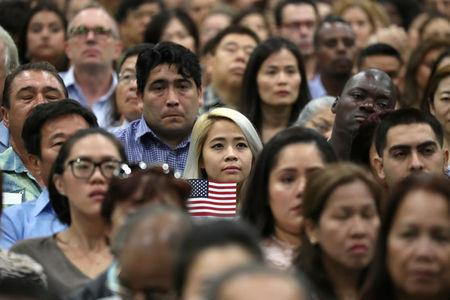 Immigrants attend a naturalization ceremony to become new U.S. citizens in Los Angeles, California, U.S., September 20, 2017. REUTERS/Lucy Nicholson