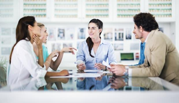 Business meeting with four women and one man.