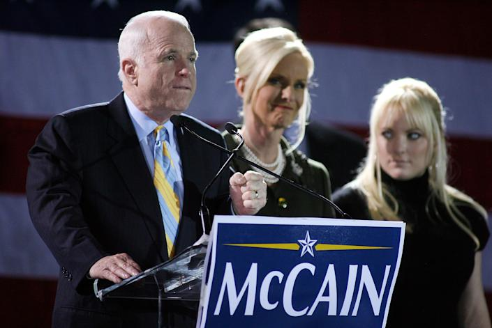 MIAMI - JANUARY 29: Republican presidential hopeful Sen. John McCain (R-AZ) speaks as his wife Cindy (C) and daughter Megan (R) look on during a post primary campaign rally at the Hilton hotel January 29, 2008 in Miami, Florida. After winning in South Carolina, McCain is the winner of the Florida Republican primary, followed by former Massachusetts Gov. Mitt Romney with former New York City mayor Rudy Giuliani running in third. (Photo by Marc Serota/Getty Images)