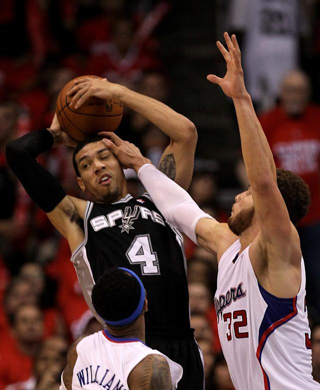 LOS ANGELES, CA - MAY 19: Danny Green #4 of the San Antonio Spurs and Blake Griffin #32 of the Los Angeles Clippers contend for the ball in Game Three of the Western Conference Semifinals in the 2012 NBA Playoffs on May 19, 2011 at Staples Center in Los Angeles, California. The Spurs won 96-86 to take a three games to none lead in the series. NOTE TO USER: User expressly acknowledges and agrees that, by downloading and or using this photograph, User is consenting to the terms and conditions of the Getty Images License Agreement. (Photo by Stephen Dunn/Getty Images)