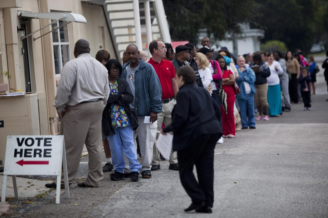 ST. PETERSBURG, FL -  NOVEMBER 6:  Lines of voters wait to cast their ballots as the polls open on November 6, 2012 in St. Petersburg, Florida. The swing state of Florida is recognised to be a hotly contested battleground that offers 29 electoral votes, as recent polls predict that the race between U.S. President Barack Obama and Republican presidential candidate Mitt Romney remains tight.  (Photo by Edward Linsmier/Getty Images)