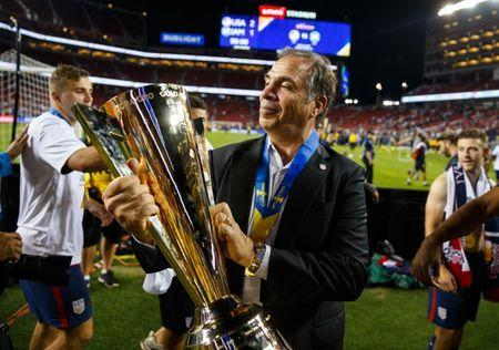 Jul 26, 2017; Santa Clara, CA, USA; United States head coach Bruce Arena celebrates with the trophy after defeating Jamaica during the CONCACAF Gold Cup final at Levi's Stadium. Mandatory Credit: Mark J. Rebilas-USA TODAY Sports