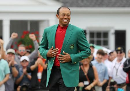 FILE PHOTO: Golf - Masters - Augusta National Golf Club - Augusta, Georgia, U.S. - April 14, 2019. Tiger Woods of the U.S. celebrates with with his green jacket after winning the 2019 Masters. REUTERS/Lucy Nicholson/File Photo