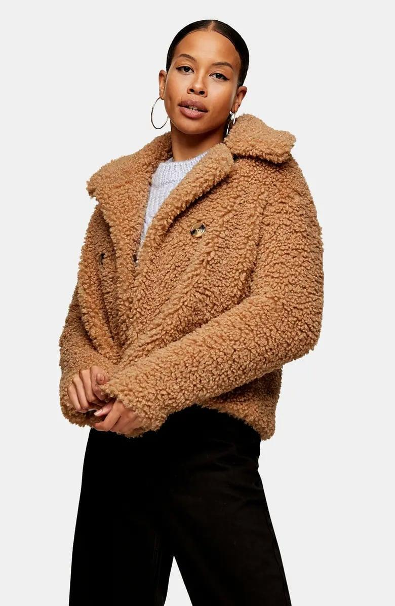 <p>Stay cozy in this <span>Topshop Ami Borg Faux Fur Jacket</span> ($135).</p>