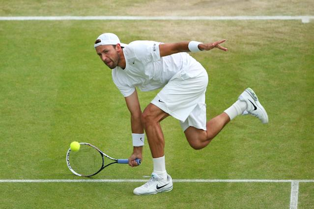 LONDON, ENGLAND - JULY 03: Lukasz Kubot of Poland plays a forehand during the Gentlemen's Singles quarter-final match against Jerzy Janowicz of Poland on day nine of the Wimbledon Lawn Tennis Championships at the All England Lawn Tennis and Croquet Club at Wimbledon on July 3, 2013 in London, England. (Photo by Julian Finney/Getty Images)