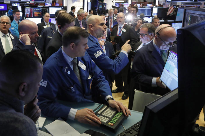 Specialist Philip Finale, background center, works with traders on the floor of the New York Stock Exchange, Monday, March 9, 2020. The Dow Jones Industrial Average plummeted 1,500 points, or 6%, following similar drops in Europe after a fight among major crude-producing countries jolted investors already on edge about the widening fallout from the outbreak of the new coronavirus. (AP Photo/Richard Drew)