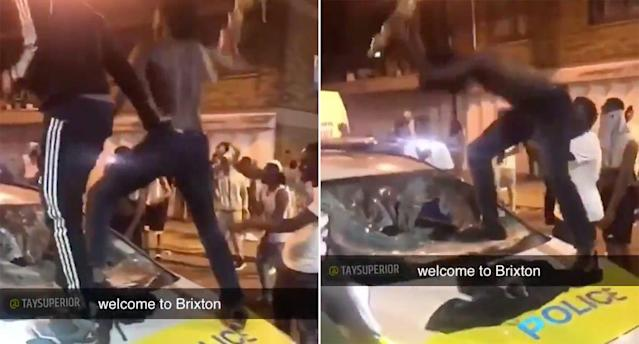 Police appear to attack a police car during an incident in Brixton, south London. (Twitter/@taysuperior)