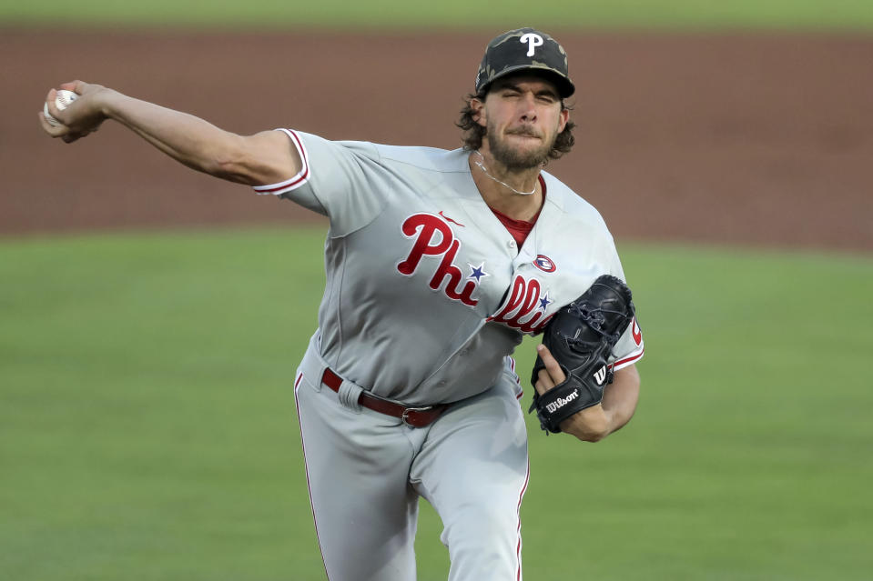 Philadelphia Phillies starting pitcher Aaron Nola throws against the Toronto Blue Jays during the first inning of a baseball game Saturday, May 15, 2021, in Dunedin, Fla. (AP Photo/Mike Carlson)