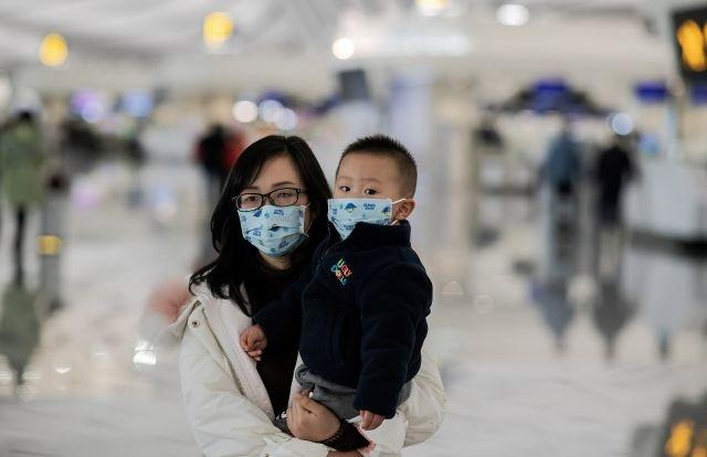 Chinese cities locked down far from virus epicentre