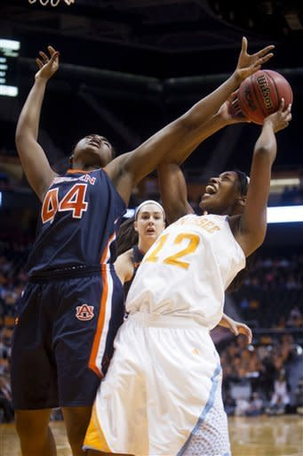 Tennessee's Bashaara Graves, right, shoots while defended by Auburn's Tra'Cee Tanner during their NCAA college basketball game, Thursday, Feb. 21, 2013, in Knoxville, Tenn. (AP Photo/The Knoxville News Sentinel, Saul Young)