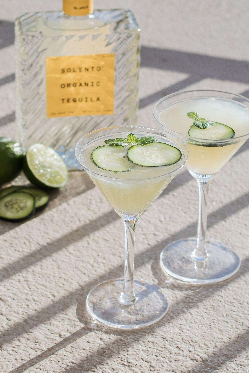 """<p>This refreshing tequila drink reminds us of sunny spa days at our favorite weekend retreat and is an excellent option for serving at your next outdoor garden party. </p><p><strong>Ingredients:</strong></p><p>4 mint leaves</p><p>4 cucumber slices</p><p>1/2 ounce agave syrup</p><p>2 ounces <a href=""""https://solentotequila.com/"""" rel=""""nofollow noopener"""" target=""""_blank"""" data-ylk=""""slk:Solento Blanco"""" class=""""link rapid-noclick-resp"""">Solento Blanco</a> tequila</p><p>3/4 ounce lime juice</p><p>Ice</p><p><strong>Directions:</strong></p><p>Gently muddle mint leaves, cucumber slices, and agave syrup in a cocktail shaker. Add tequila, lime juice, and ice, then shake and strain into a martini glass. Garnish with extra mint leaves and cucumber slices. </p>"""