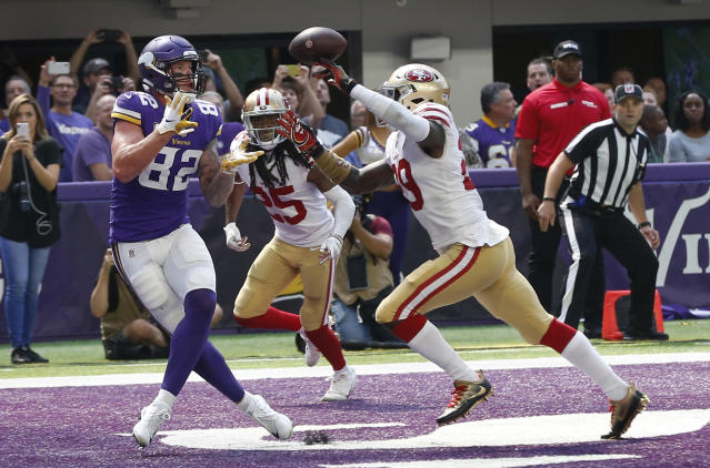<p>Minnesota Vikings tight end Kyle Rudolph (82) catches an 11-yard touchdown pass in front of San Francisco 49ers safety Jaquiski Tartt, right, during the second half of an NFL football game, Sunday, Sept. 9, 2018, in Minneapolis. (AP Photo/Jim Mone) </p>