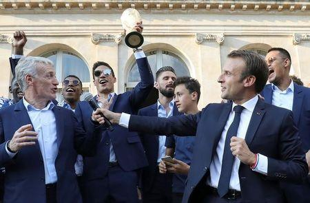France's coach Didier Deschamps speaks next to French President Emmanuel Macron during a reception at the Elysee Presidential Palace, after French players won the Russia 2018 World Cup final football match, in Paris, France July 16, 2018. Ludovic Marin/Pool via Reuters