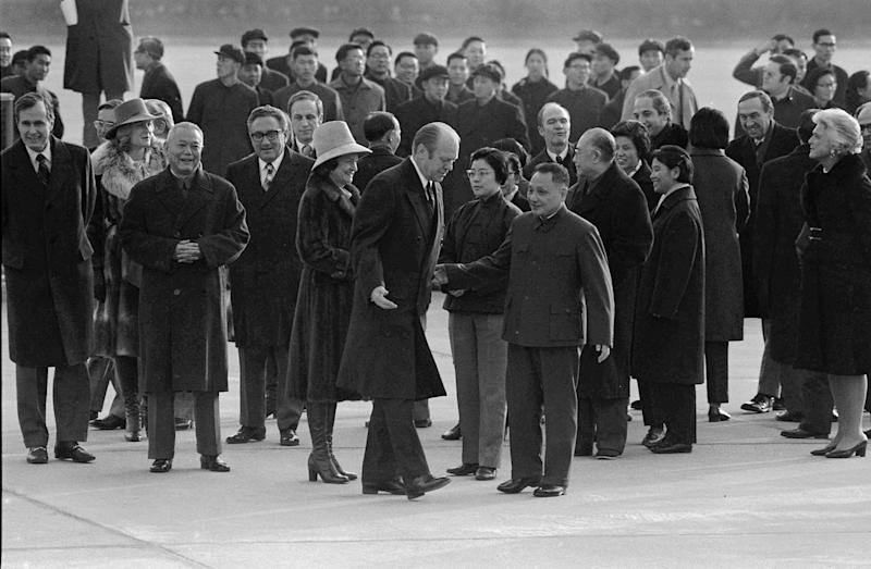 FILE - In this Dec. 1, 1975, file photo, Chinese leader, Communist revolutionary Deng Xiaoping,Vice premier, center right, walks with U.S. President Gerald Ford, center left, during Ford's arrival in Beijing. (AP Photo/File)