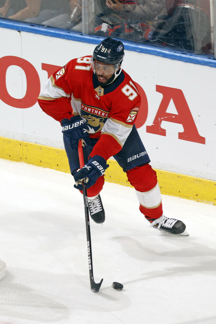 Florida Panthers left wing Anthony Duclair (91) looks to pass the puck in front of the Tampa Bay Lightning net during the second period in Game 1 of an NHL hockey Stanley Cup first-round playoff series, Sunday, May 16, 2021, in Sunrise, Fla. (AP Photo/Joel Auerbach)