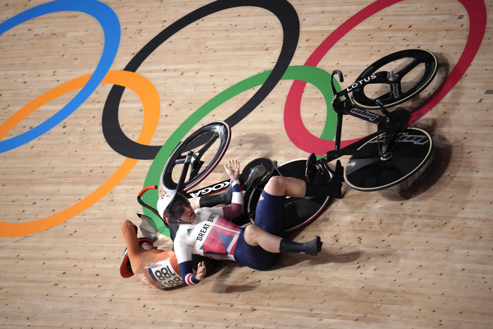 Katy Marchant of Team Great Britain crashes with Laurine van Riessen of Team Netherlands (188) during the track cycling women keirin at the 2020 Summer Olympics, Thursday, Aug. 5, 2021, in Izu, Japan. (AP Photo/Christophe Ena)
