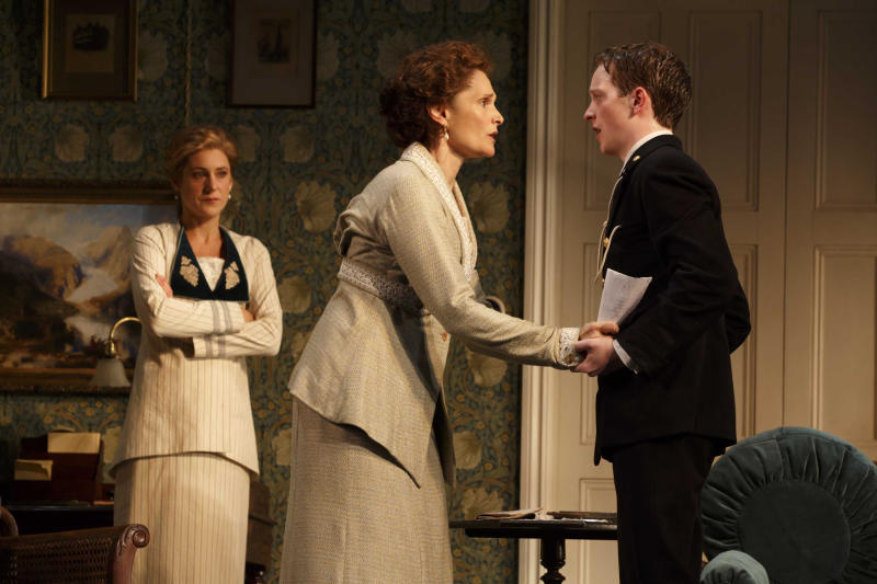 """This image released by Polk PR shows, from left, Charlotte Parry, Mary Elizabeth Mastrantonio and Spencer Davis Milford in a scene from """"The Winslow Boy,"""" at the American Airlines Theatre in New York. (AP Photo/Polk PR, Joan Marcus)"""