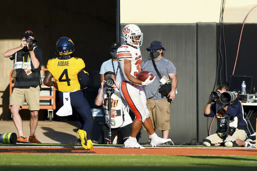 Hubbard, No. 15 Oklahoma State, escape with another victory