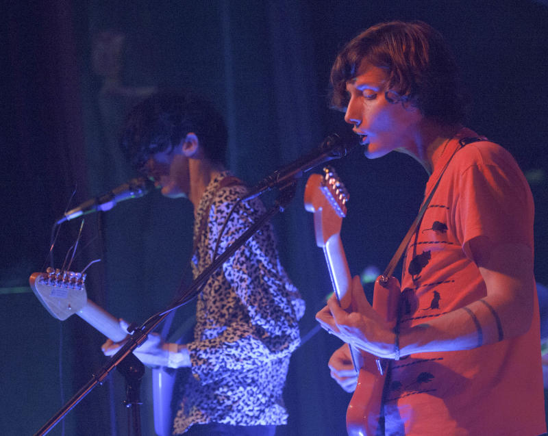 Bradford Cox, left, and Lockett Pundt sing and play guitar along with other members of the indie rock group Deerhunter, at One Eyed Jack's in the French Quarter in New Orleans, Monday, April 29, 2013. (AP Photo/Matthew Hinton)