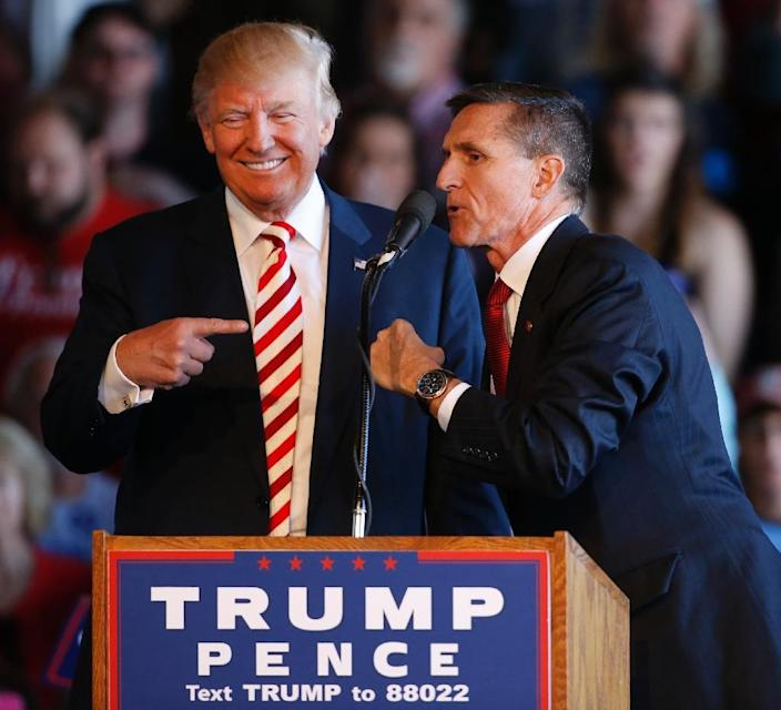 Retired General Michael Flynn (R), who could end up in a Donald Trump administration cabinet, was mentioned as a possible Trump running mate (AFP Photo/George Frey)