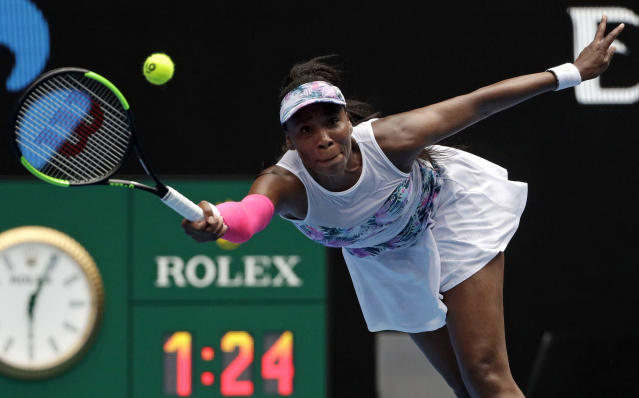 United States' Venus Williams reaches for a forehand return to Romania's Mihaela Buzarnescu during their first round match at the Australian Open tennis championships in Melbourne, Australia, Tuesday, Jan. 15, 2019. (AP Photo/Mark Schiefelbein)