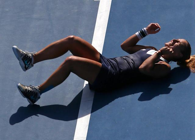 Dominika Cibulkova of Slovakia celebrates after defeating Agnieszka Radwanska of Poland during their semifinal at the Australian Open tennis championship in Melbourne, Australia, Thursday, Jan. 23, 2014.(AP Photo/Eugene Hoshiko)