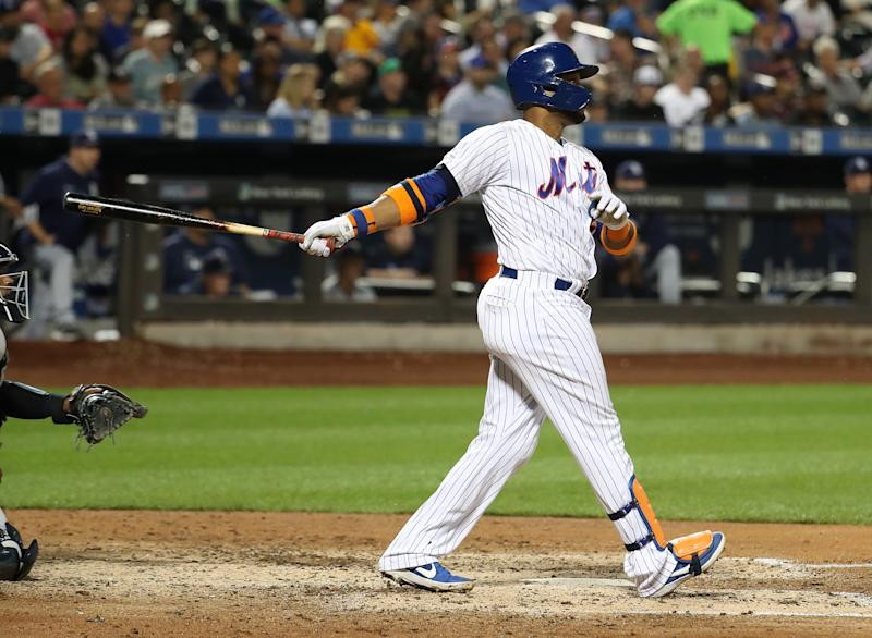 NEW YORK, NEW YORK - JULY 23: Robinson Cano #24 of the New York Mets hits a sixth inning home run against the San Diego Padres during their game at Citi Field on July 23, 2019 in New York City. (Photo by Al Bello/Getty Images)